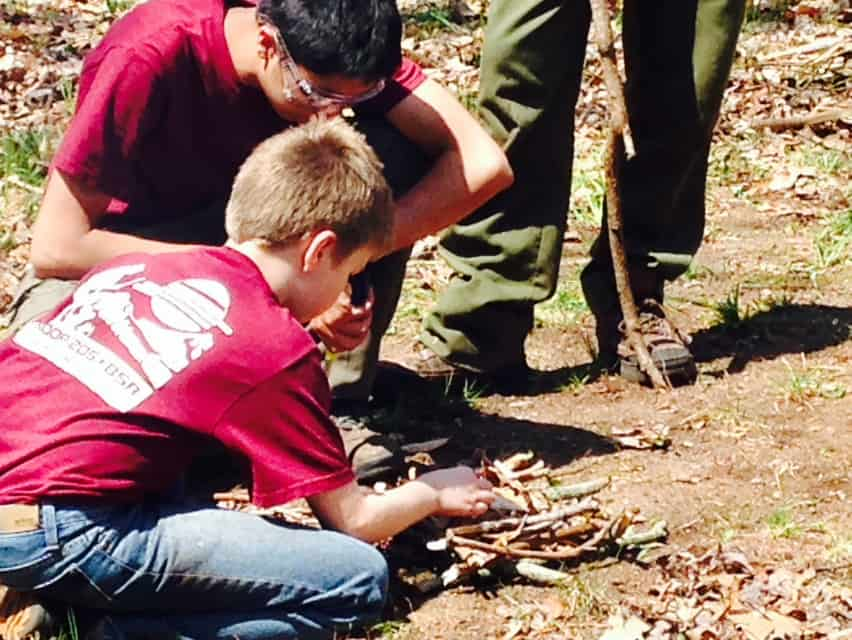 Troop 205 scouts learning how to start a campfire